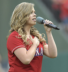 September 12, 2017 - Arlington, TX, USA - Holly Tucker, from Season 4 of the Voice, sings the national anthem as the Texas Rangers play host to the Seattle Mariners at Globe Life Park in Arlington, Texas, on Tuesday, Sept. 12, 2017. (Credit Image: © Max Faulkner/TNS via ZUMA Wire)