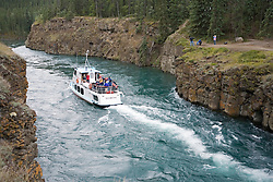 M.V. Schwatka cruises the Yukon River through Miles Canyon at the suspension bridge