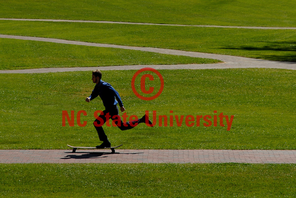 Student zips along the Court of the Carolinas on his longboard.    photo by Roger Winstead