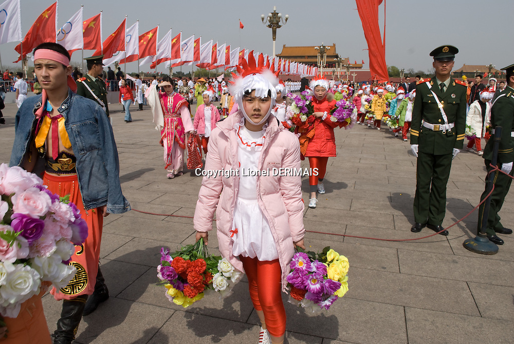 Children at the olympic torch ceremony on Tian'an men square, Beijing, China.