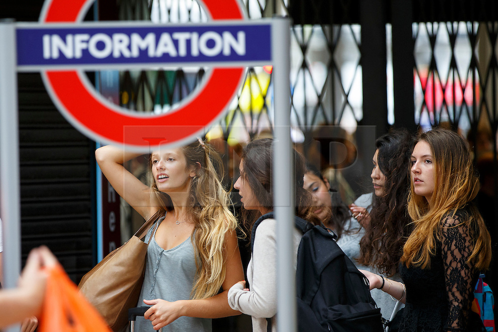 © Licensed to London News Pictures. 08/07/2015. London, UK. A group of tourists queuing outside Victoria tube station ahead of the Tube strike in the evening rush hour of Monday, July 8, 2015. The strike will be a 27-hour stoppage by about 20,000 Tube staff to shut down the entire London Underground network. Photo credit: Tolga Akmen/LNP