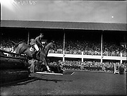 "05/08/1960<br /> 05/08/1960<br /> 05 August 1960<br /> R.D.S Horse Show Dublin (Friday). Aga Khan Trophy. David Broome of Great Britain clearing the last jump in the Aga Khan Trophy on ""Sunsalve"" at the Dublin Horse Show."