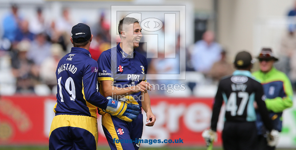 Paul Coughlin (right) of Durham County Cricket Club is congratulated on taking a wicket during the Royal London One Day Cup match at Emirates Durham ICG, Chester-le-Street<br /> Picture by Simon Moore/Focus Images Ltd 07807 671782<br /> 14/08/2014