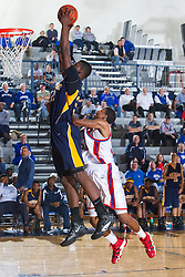 Northeast's Alex Poythress, left, is fouled by Lafayette's Chester Tranard in the second half. Lafayette hosted Northeast (TN)  Saturday, Jan. 07, 2012 at Lexington Catholic Gym in Lexington.
