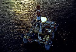 Stock photo of an aerial sunset view of a semi submersible rig
