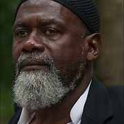 Portrait of the African Muslim  male from West Africa wearing black skull cap, head covering at the Solidarity Rally in New York City