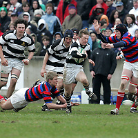 PBC  Shane Costigan gets away from the tackle of St.Munschin's Paul Rowley and  Jonathon Griffin  during their Munster Schools Senior Cup Final<br />Played in Thomand Park Limerick.<br />Pic.Brian Gavin/Press 22