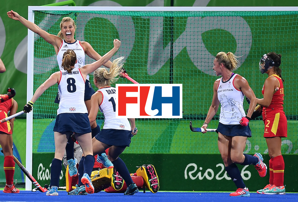 Britain's Georgie Twigg (top L) celebrates a goal during the women's quarterfinal field hockey Britain vs Spain match of the Rio 2016 Olympics Games at the Olympic Hockey Centre in Rio de Janeiro on August 15, 2016. / AFP / MANAN VATSYAYANA        (Photo credit should read MANAN VATSYAYANA/AFP/Getty Images)