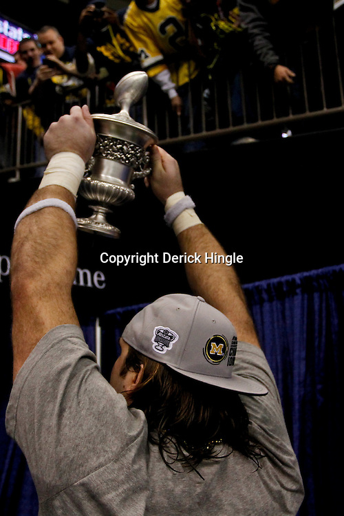 January 3, 2012; New Orleans, LA, USA; Michigan Wolverines defensive end Ryan Van Bergen (53) carries the Sugar Bowl trophy following an overtime win over the Virginia Tech Hokies in the Sugar Bowl at the Mercedes-Benz Superdome. Michigan defeated Virginia 23-20 in overtime. Mandatory Credit: Derick E. Hingle-US PRESSWIRE