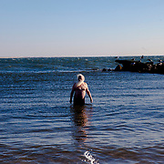 BROOKLYN, NY - JANUARY 1, 2015:  Dick Shea takes a solitary dip in the water near the end of the Coney Island Polar Bear Club's annual polar bear plunge on New Years Day. CREDIT: Sam Hodgson for The New York Times