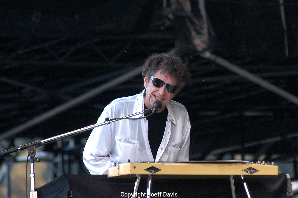 """Manchester, TN-June 11, 2004: Bob Dylan performs on the """"What Stage"""" at the 2004 Bonnaroo festival."""