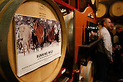 Wine barrels are decorated with promotional material during a special preview of Running Wild, a documentary on the life of wild horse rescuer Dayton O. Hyde, at Big Dog Vineyards in Milpitas, California, on March 8, 2013. (Stan Olszewski/SOSKIphoto)