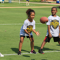 Arianna Spaulding, 7, prepares to catch the ball Saturday during the All-Star Football Camp benefiting the Boys and Girls Clubs of North Mississippi at Ballard Park
