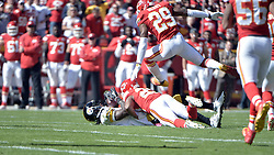Oct 25, 2015; Kansas City, MO, USA; Pittsburgh Steelers wide receiver Markus Wheaton (11) catches a pass and is tackled by Kansas City Chiefs cornerback Marcus Peters (22) and free safety Eric Berry (29) during the first half at Arrowhead Stadium. Mandatory Credit: Denny Medley-USA TODAY Sports
