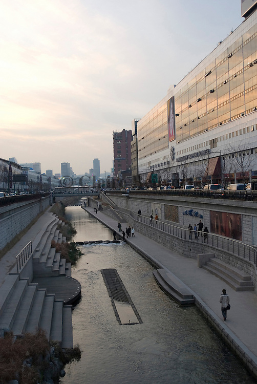 People walking along the Cheonggye stream. This Seoul area is part of a urban renewal effort.