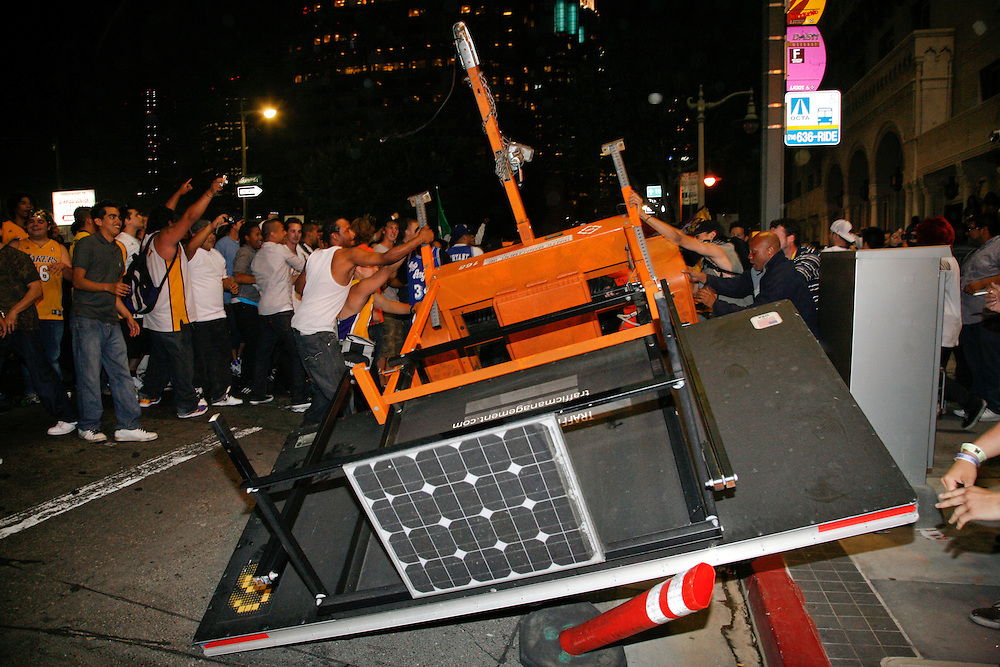 Fans turn over a giant traffic sign as they celebrate the Los Angeles Laker's victory in the 2010 NBA Finals Championship against the Boston Celtics near the Staples Center in Los Angeles California, USA, 17 June 2010.