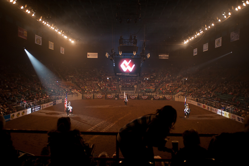 Flagbearers on horseback at the Denver Coliseum during the opening ceremonies of a rodeo on Thursday, January 24 at the National Western Stock Show.