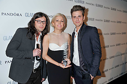 ELLIE GOULDING and Jared Followill; Nathan Followill from the Kings of Leon at the Glamour Women of The Year Awards 2011 held in Berkeley Square, London W1 on 7th June 2011.