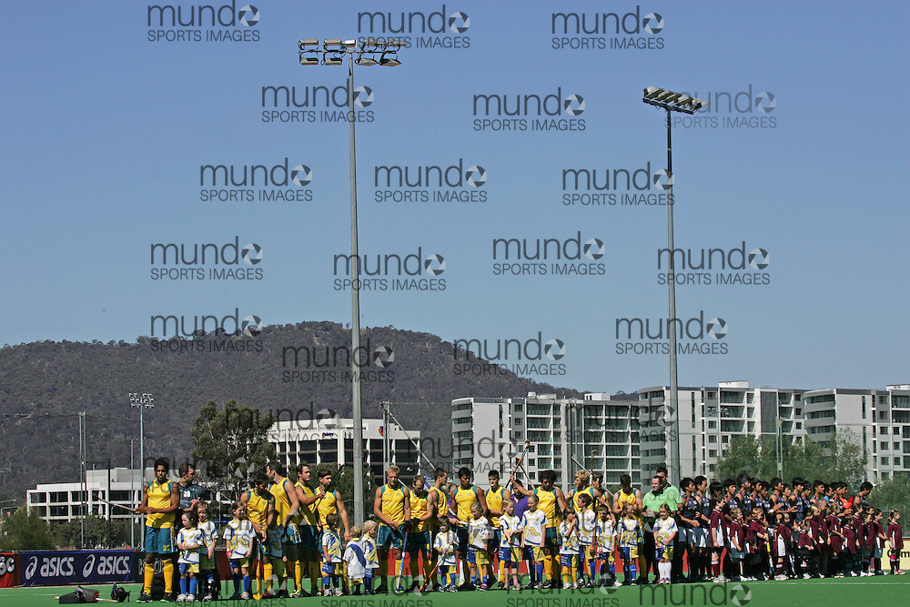 (Canberra, Australia---31 March 2012) \Team introductions\ playing the second of a three game field hockey test match series between Australia and Japan men's field hockey teams. 2012 Copyright Photograph Sean Burges / Mundo Sport Images.(Canberra, Australia---31 March 2012) \Team introductions\ warming up before the  second of a three game field hockey test match series between Australia and Japan men's field hockey teams. 2012 Copyright Photograph Sean Burges / Mundo Sport Images.