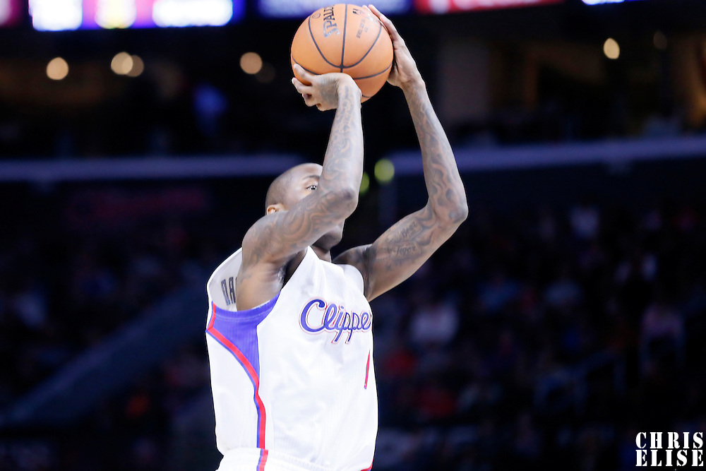 10 January 2014: Los Angeles Clippers guard Jamal Crawford (11) takes a jump shot during the Los Angeles Clippers 120-100 victory over the Dallas Mavericks, at the Staples Center, Los Angeles, California, USA.