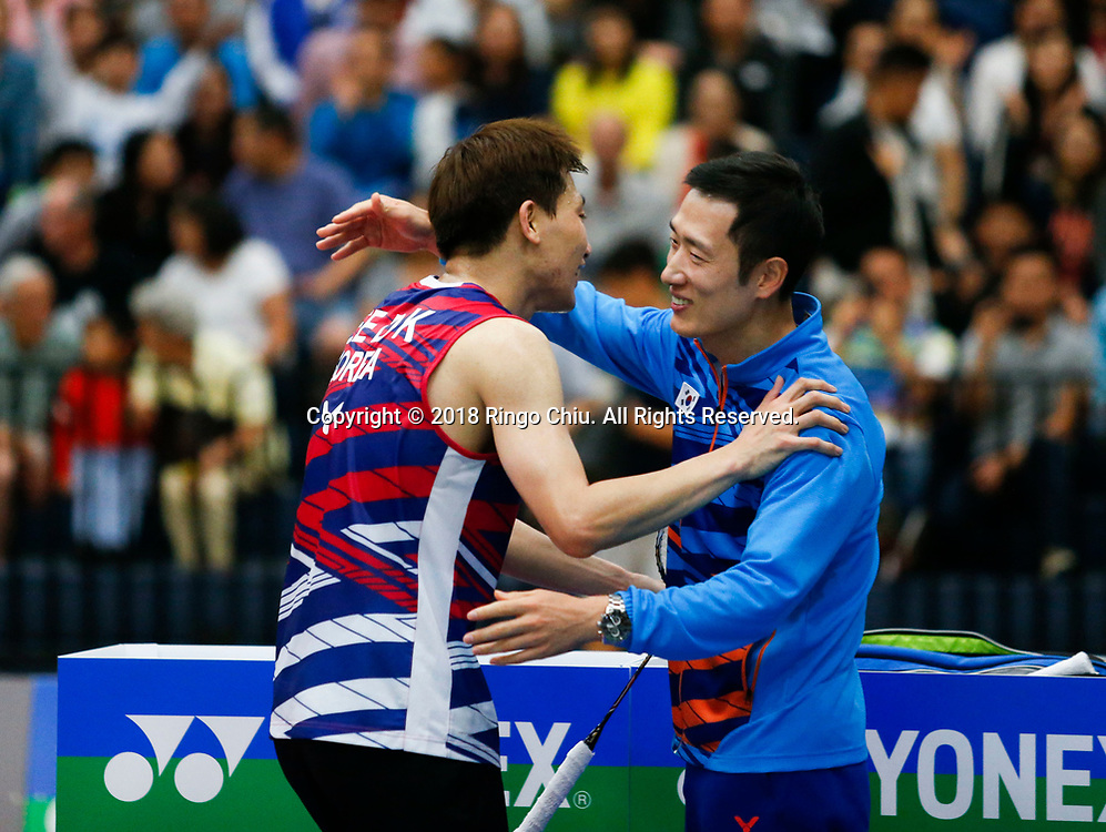Lee Dong Keun of Korea, celebrats with his coach after defeating Mark Caljouw of Netherland, during the men's singles final match at the U.S. Open Badminton Championships in Fullerton, California, on June 17, 2018. Lee won 2-1. (Photo by Ringo Chiu)<br /> <br /> Usage Notes: This content is intended for editorial use only. For other uses, additional clearances may be required.