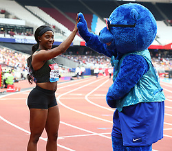 July 21, 2018 - London, United Kingdom - Shelly-Ann Fraser -Pryce  Winner of the 100m Women does a high five with  Britbear during the Muller Anniversary Games IAAF Diamond League Day One at The London Stadium on July 21, 2018 in London, England. (Credit Image: © Action Foto Sport/NurPhoto via ZUMA Press)