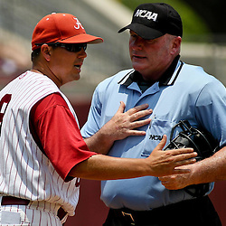 June 05, 2011; Tallahassee, FL, USA; Alabama Crimson Tide head coach Mitch Gaspard argues with home plate umpire Mike Duffy during the fourth inning of the Tallahassee regional of the 2011 NCAA baseball tournament at Dick Howser Stadium. Mandatory Credit: Derick E. Hingle