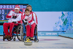 Svetlana Pakhomova, Marat Romanov, Alexander Shevchenko, Wheelchair Curling Semi Finals at the 2014 Sochi Winter Paralympic Games, Russia