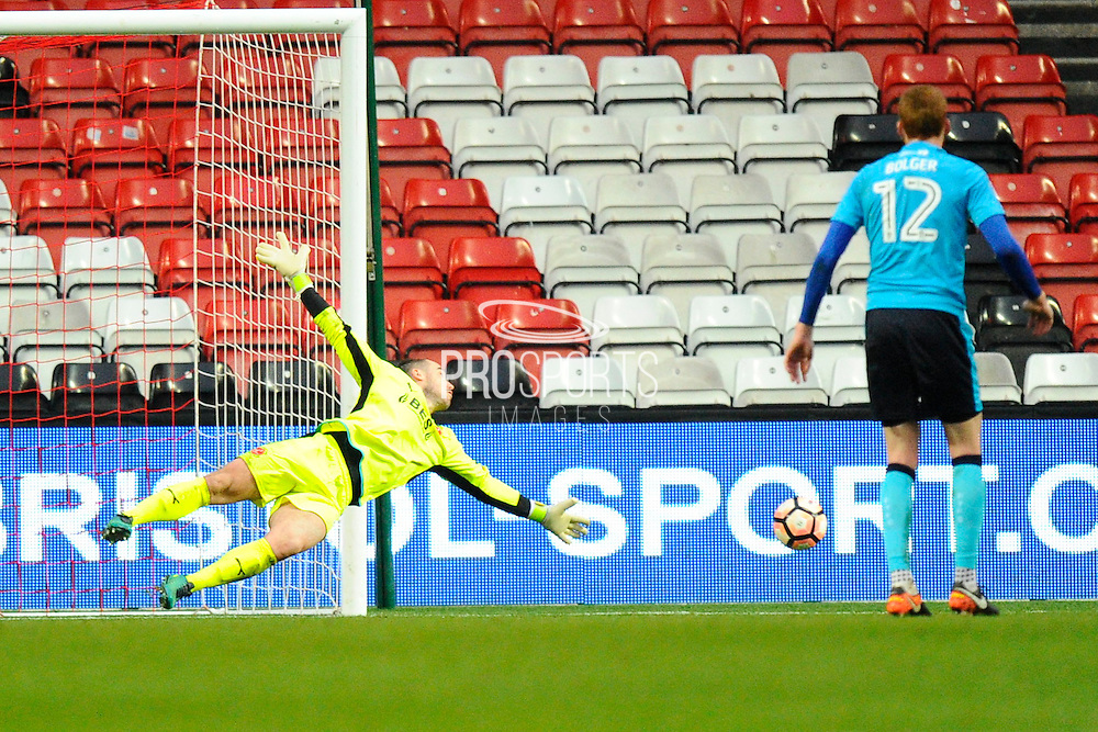Alex Cairns (21) of Fleetwood Town makes a dive to cover a Bristol City shot during the The FA Cup match between Bristol City and Fleetwood Town at Ashton Gate, Bristol, England on 7 January 2017. Photo by Graham Hunt.