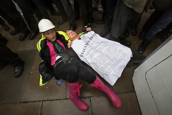 © licensed to London News Pictures. London, UK 19/10/2012. Protesters sitting on the floor outside Department for Communities and Local Governments in London during a protest to mark the first anniversary of the Dale Farm eviction. Photo credit: Tolga Akmen/LNP