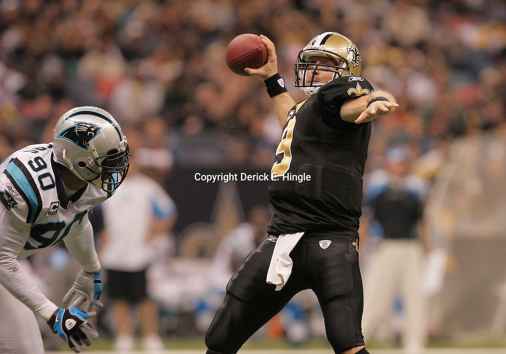 2008 December, 28: New Orleans Saints quarterback Drew Brees (9) throws as Carolina Panthers defensive end Julius Peppers (90) provides  pressure on the play during a 33-31 week 17 loss by the New Orleans Saints to NFC South divisional rivals the Carolina Panthers at the Louisiana Superdome in New Orleans, LA.