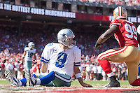 18 September 2011: Quarterback (9) Tony Romo of the Dallas Cowboys watches the play after getting thrown to the ground by (99) Aldon Smith of the San Francisco 49ers during the second half of the Cowboys 27-24 overtime victory against the 49ers in an NFL football game at Candlestick Park in San Francisco, CA.