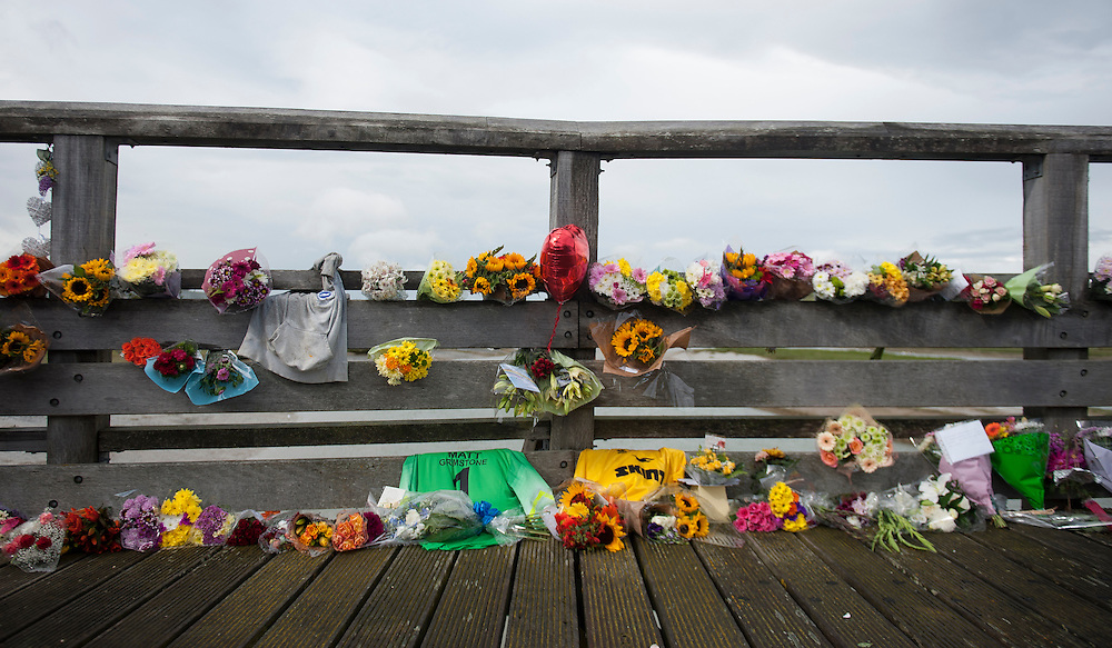 Flowers left close to the site of the Shoreham Air Crash in Shoreham, West Sussex, Britain, 24 August 2015. The crash took place after a Hawker Hunter jet crashed into the A27 road during an Shoreham Airshow on 22 August. The death toll is expected to raise above the estimated 11 known victims. EPA/WILL OLIVER