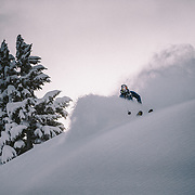 Tyler Hatcher skis a powder haven during a winter whiteout in the backcountry near Mount Baker Ski Area in Washington State.