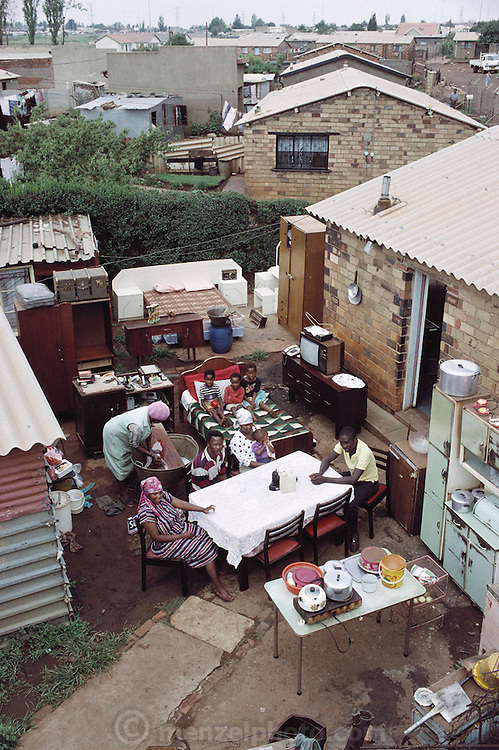 The Samuel Msomi family in Soweto, South Africa with all their possessions in the back yard of their house. This family was not chosen for the Material World book, but they are, like the Qampie family in the book, statistically average for South Africa.