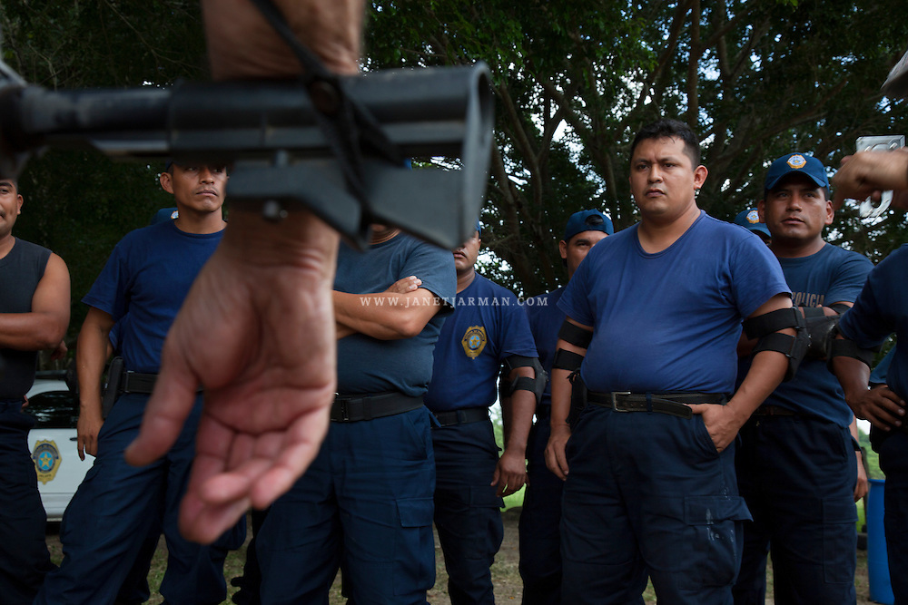 Paquin Flores and his colleagues listen to weapons instruction by Israeli foreign security experts during a training class near Jalapa, a small town in Mexico's Tabasco state.During initial stages of building  a police force, Jalapa's mayor conducted medical tests and found that many officers were overweight and suffered from diabetes and hypertension. Some had not touched a gun in 10 years, he said. Thus, training became an immediate priority, along with buying patrol vehicles.