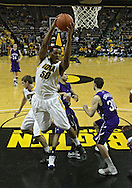 January 12 2010: Iowa Hawkeyes forward Jarryd Cole (50) grabs a rebound during the first half of an NCAA college basketball game at Carver-Hawkeye Arena in Iowa City, Iowa on January 12, 2010. Northwestern defeated Iowa 90-71.