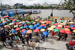 © licensed to London News Pictures. 19/06/2011. London, UK.  Hundreads of refugees, asylum seekers, charity group members and supporters parade through London from Embankment to the South Bank with colourful umbrellas today (19/06/2011) as a symbol of protection for refugees, to start Refugee Week 2011 (20-26 June 2011). Photo credit should read: Ben Cawthra/LNP