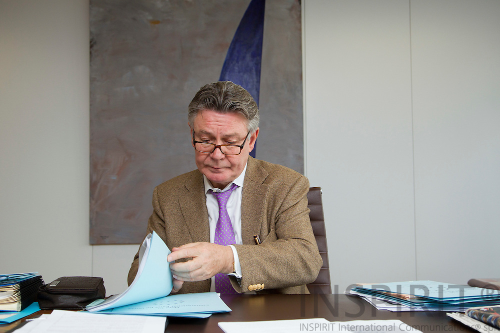 Karel De Gucht, European Union Commissioner for Trade signing documents at his Brussels office Wednesday 18 May 2011.  Photo: Erik Luntang / INSPIRIT Photo