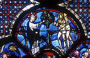 God warning Adam and Eve not to eat the fruit of the tree of knowledge'. Chartres Cathedral: The Good Samaritan window, 13th century.