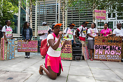 London, UK. 10 July, 2019. A Movement for Justice campaigner implores the Home Office on her knees as she addresses a protest outside the Home Office against the government department's decision to try to block the return to the UK of PN, a Ugandan lesbian removed from the UK using the now unlawful fast track procedure in 2013 but who the High Court ordered on 24th June must be returned to the UK by the Home Office after the handling of her case was ruled to be 'procedurally unfair'.