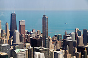 Aerial view of Chicago IL, Trump tower and the John Hancock building, as seen from the Willis tower observation deck.
