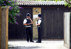 The body of a woman has been found in a lock-up garage in London by police investigating the case of missing oil executive Carole Waugh as Police guard the site where a woman's body was found at a set of lock up garages in Lime Close, New Malden, Surrey yesterday, Friday August 3, 2012. Photo by i-Images
