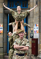 Brigadier Gary Deakin CBE welcomes performers to the Army reserve centre at Hepburn House for the opening of the Army's first ever Edinburgh Festival Fringe venue.<br /> <br /> Pictured: Performers from the Rosie Kay Dance Company production of 5 Soldiers with Brigadier Gary Deakin CBE