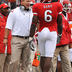 Sep 12, 2009; Piscataway, NJ, USA;  Rutgers head coach Greg Schiano talks to Rutgers wide receiver Mohamed Sanu (6) during the first half of Rutgers' 45-7 victory over Howard in NCAA College Football at Rutgers Stadium.