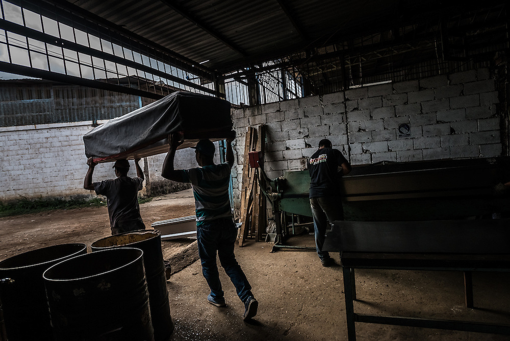 CARACAS, VENEZUELA - MAY 8, 2015: Workers build caskets in an industial park outside of Caracas. Venezuela has the second highest murder rate in the world, after Honduras, according to the Venezuelan Violence Observatory. Last year, there were 82 homicides for every 100,000 citizens last year, with a total of 24,980 homicides, it said. The violence is only growing — but shortages are hitting casket-makers too.  Raw materials, like steel plates, fabric and glue, are becoming increasingly hard to find, forcing many in the industry to produce wood caskets instead, which are twice as expensive as metal ones. There is now a 30 percent shortage of caskets in the country, said Eduardo Vallés, president of the Professional Association of the Funeral Industry. He says a number of companies have closed in recent months and the ones still in business have to operate with diminishing stock.  In remote towns where shortages are more acute and caskets have become an unattainable luxury, people have recently been buried in sheets, Vallés said.  PHOTO: Meridith Kohut for Buzzfeed News