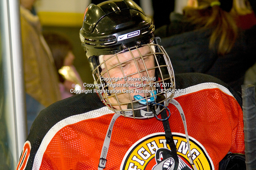 Portrait of a happy middle aged hockey player in uniform age 39. Minneapolis Minnesota MN USA