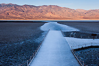 United States, California, Death Valley. Badwater is a salt flat 86 meters (282 ft) below sea level. Early in the morning,  the sun rises.