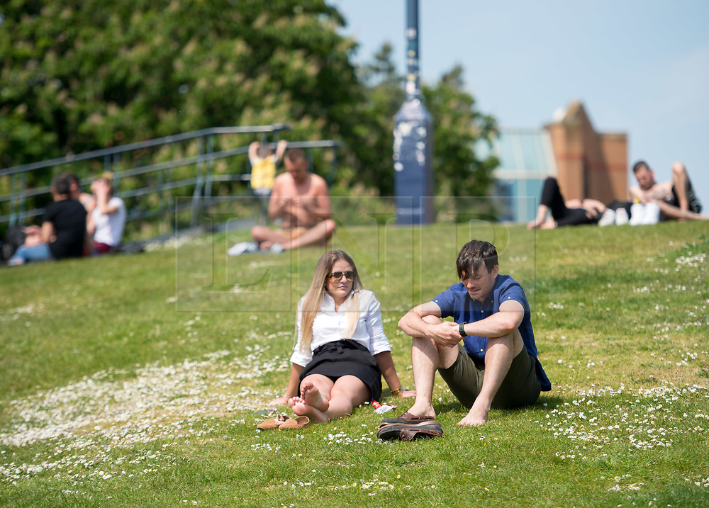 © Licensed to London News Pictures. 15/05/2019. Bristol, UK. People enjoy the warm sunshine and good weather in Bristol's Castle Park in the city centre. Photo credit: Simon Chapman/LNP