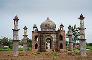 25th June 2013, Kesher Kala, India. Mr Faisal Hasan Quadri, 77, stands in the doorway of the Taj-Mahal inspired mausoleum he has built in the town of Kesher Kala, near Bulandshahr in Uttar Pradesh, India on the 25th June 2013. <br /> <br /> Faisal Hasan Quadri, 77, is building a mausoleum which he refers to as 'yaadgaar' meaning 'in memory of', to honour the memory of his late wife Begum Tajmulli, who died on the 23rd September 2011, aged 73. Quadri, a retired postal clerk began work on the tomb resembling a miniature Taj Mahal, 6 months after Begum died, in February 2012. He has so far spent 9 lakhs (approx £10,000) on it which he has largely funded by sellng a parcel of land. There's more to do to complete the structure and he even wants to establish a garden to surround it but his funds are now limited.<br /> <br /> PHOTOGRAPH BY AND COPYRIGHT OF SIMON DE TREY-WHITE<br /> <br /> + 91 98103 99809<br /> email: simon@simondetreywhite.com photographer in delhi